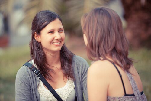 Two women are having a friendly conversation.