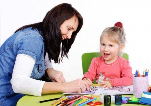 Child psychology woman coloring with child