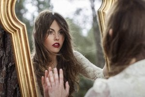 A woman looking in the mirror.