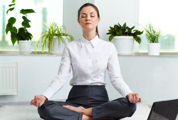 A business woman meditating.