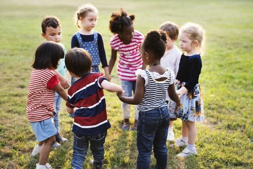 Children holding hands in a circle.
