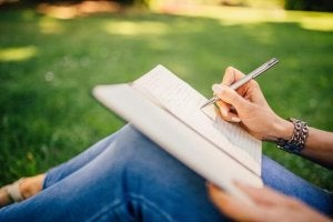 Journaling in the grass.