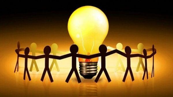 Figures surrounding a light bulb