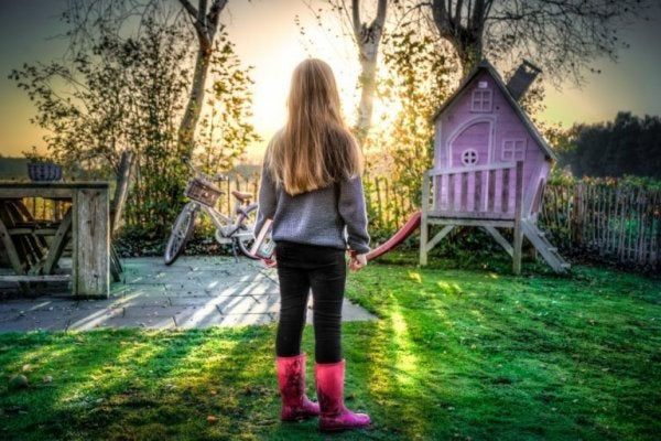 Girl looking at garden