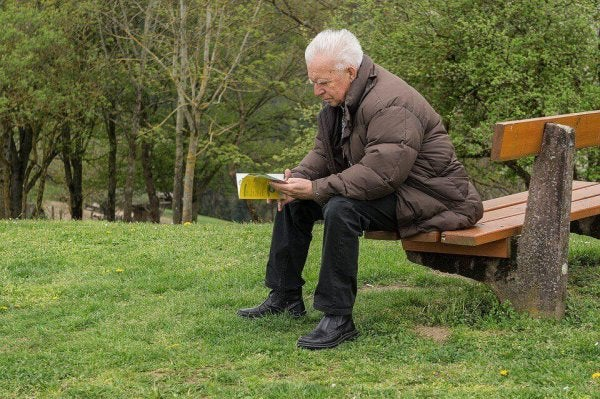 Man reading a book representing collective memory