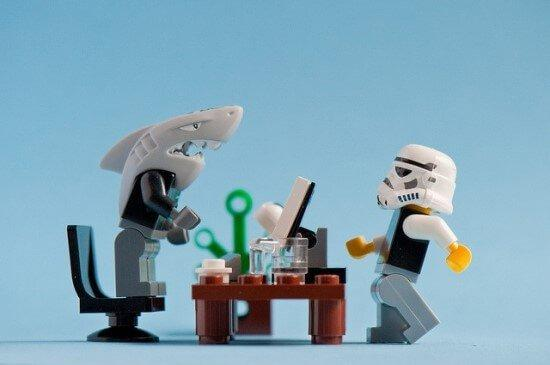 A shark and a lego man at work.