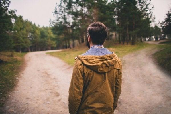 Man facing two roads