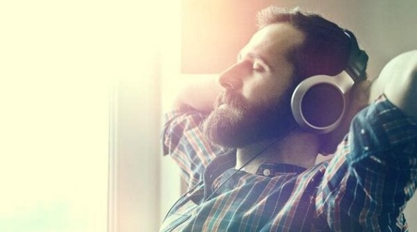 A man is listening to relaxing music.