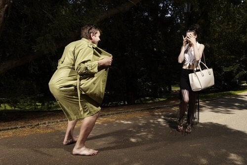 man flashing a surprised woman