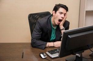 Man yawning at work