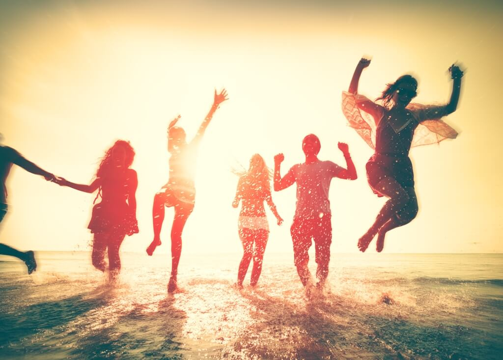 Friends having fun on the beach.