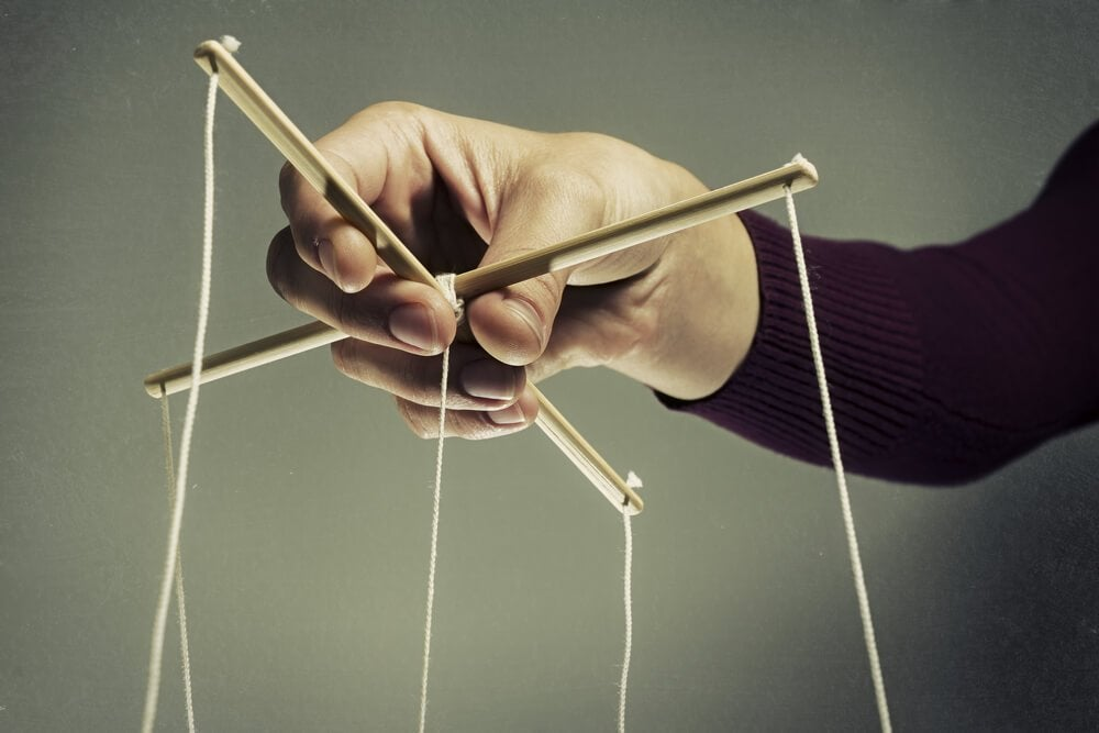 Techniques of manipulation: puppet strings.
