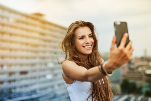 A woman taking a selfie.