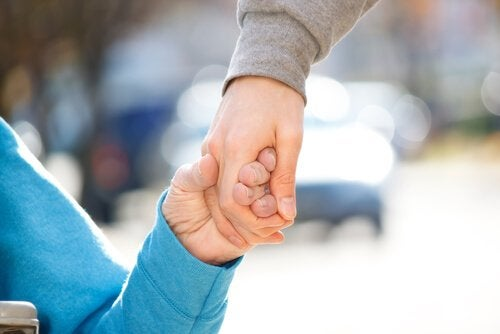 Someone holding an elderly person's hand.