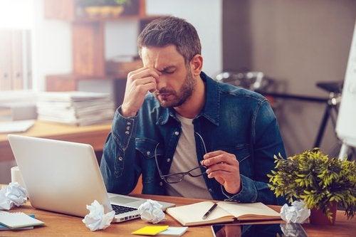 Types of procrastinators: a man working hard at his computer.