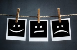 Three faces are drawn with three different emotions.