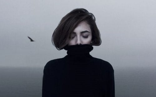 A woman in a black turtleneck.