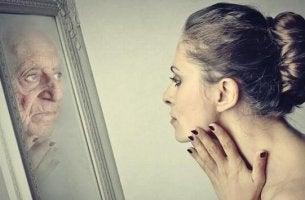 Woman looking at mirror representing Dorian Gray syndrome