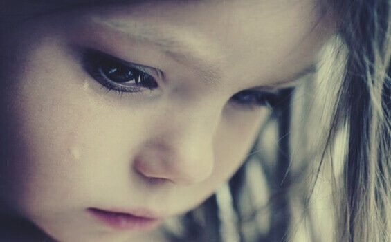 A girl crying because her childhood was stolen.