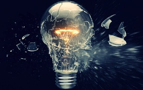 A light bulb blowing up as a sign of obsolescence
