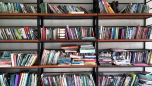 A messy bookshelf in hoarding disorder.