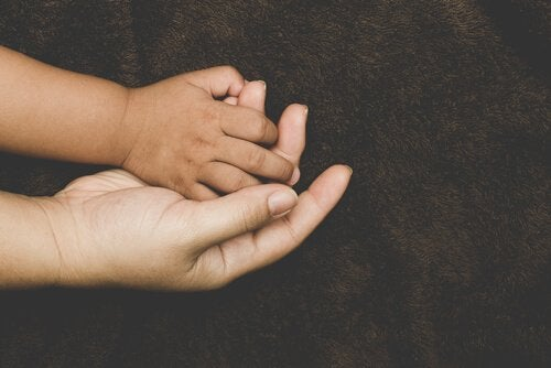 adopted child holding mother's hand