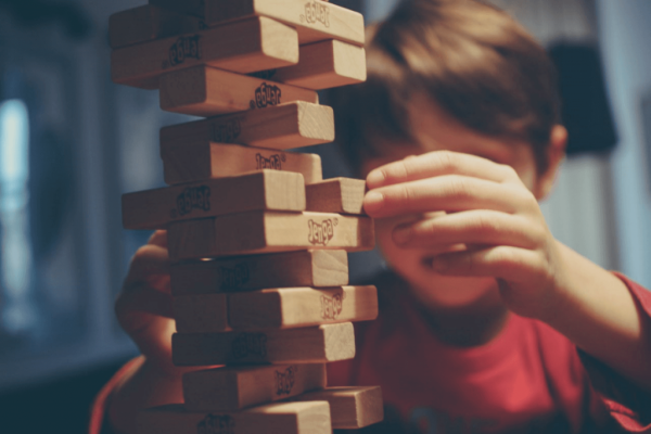 A boy playing jenga.