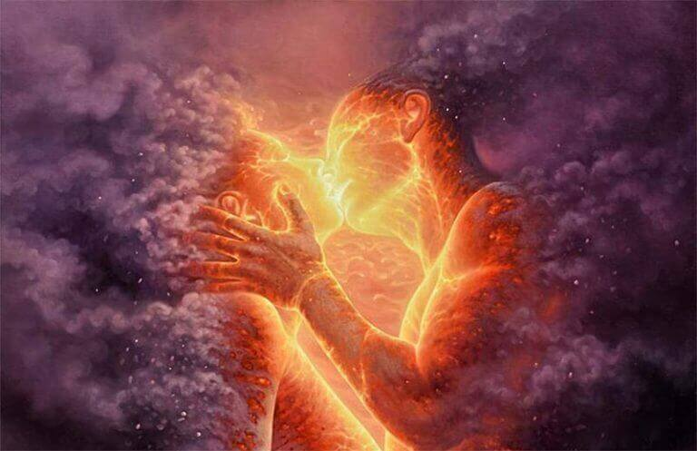 A couple wrapped in fire kissing.