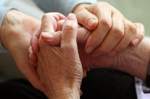 compassion as pictured by holding hands.