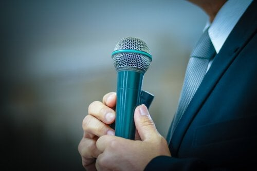 man with stage fright holding microphone
