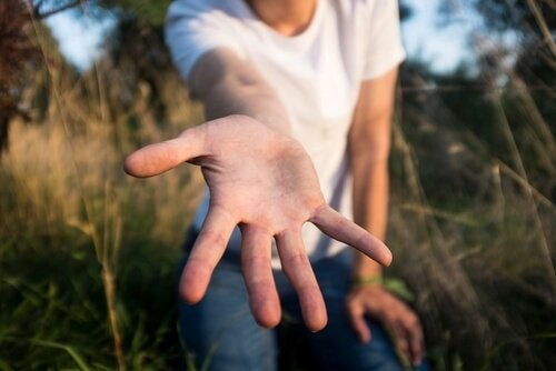 outstretched hand symbolizing philanthropy
