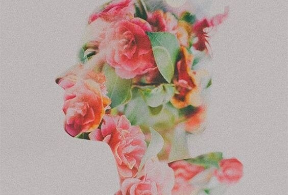 A silhouette of a woman covered in flowers.