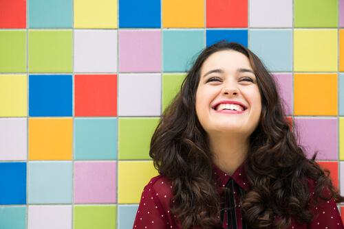 smiling woman representing pragmatic optimism