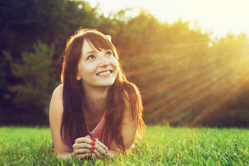 woman on grass representing pragmatic optimism