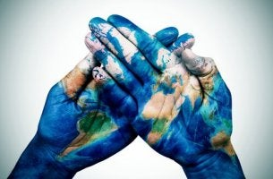 world painted on hands
