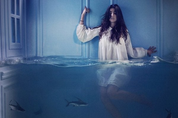Girl submerged in water: fear masquerading as laziness.