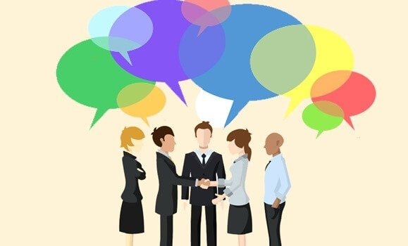 A business meeting with speech bubbles.