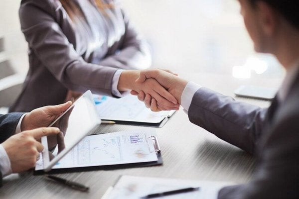 Shaking hands at an interview or meeting.
