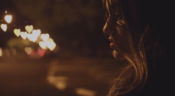 A woman at night.