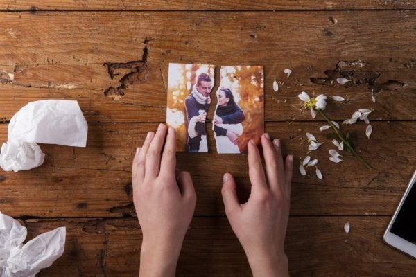 torn photo symbolizing one of the myths about infidelity, that there's no love anymore