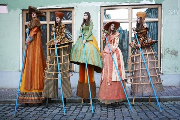 ladies on stilts