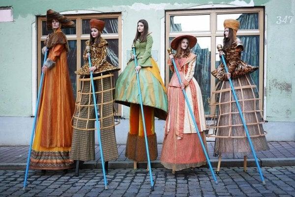ladies on stilts