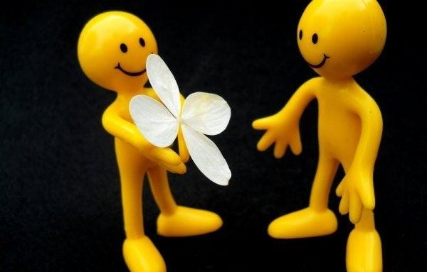 Offering a flower.