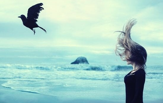 girl watching crow (symbol for emotional takers) fly away
