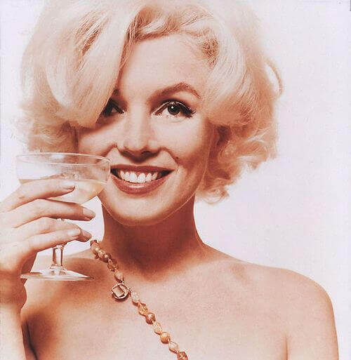 marilyn monroe holding a wine glass