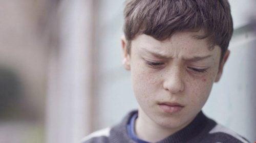 boy experiencing verbal abuse in childhood