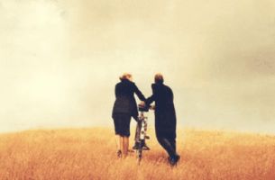 Couple walking with bikes