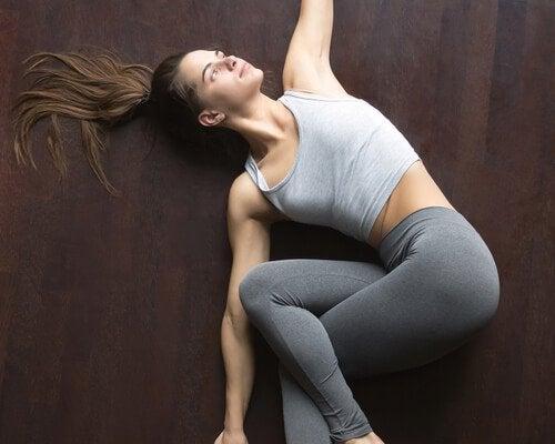 Girl exercising on floor