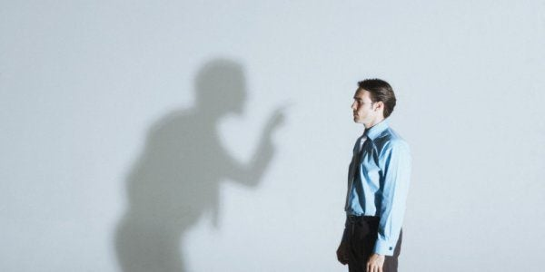 Man arguing with own shadow