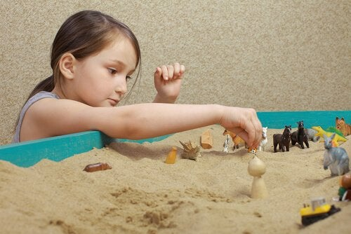 girl playing sandbox